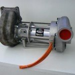 In this concept, used by Mercedes, Ferrari, and Borg Warner, the generator is located in the middle of the turbocharging system. Mercedes, currently the most successful F1 car, separate the turbo from the compressor as much as possible. Their turbo is located at engine rear; compressor engine front.