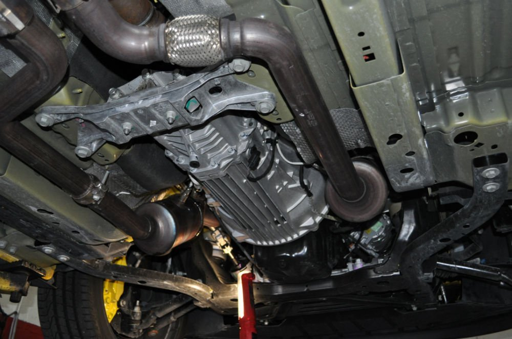 Disconnect the shifter, O2 sensors, all wiring connections, starter motor and exhaust system. Remove driveshaft, after marking the flange to maintain alignment, and transmission. Undo the bell housing and clutch cover assembly.