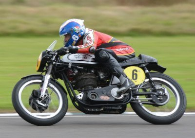 Former GP bike racer turned truck racer and TV host Steve Parrish took to Goodwood with this Manx Norton and his love of the daring act and the big moment.