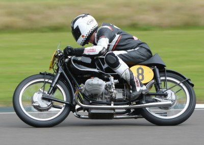 The 1954 DOHC BMW RS54 weighed 286lbs (22lbs lighter than the Manx Norton), displaced 499cc, and produced 45hp—five fewer than the Manx Norton.