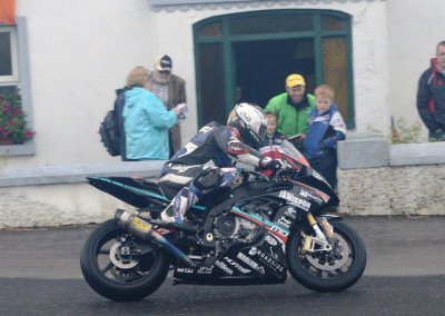 Michael Dunlop secured victory in Race 1, the Open Championship event, holding off determined challenge from Derek Sheilds