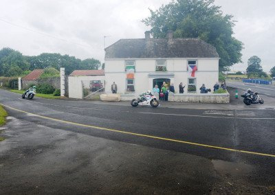 Peat burns in the fireplace as riders negotiate the Mullingar hairpin, one of the three tight turns on the triangular 2.0-mile circuit