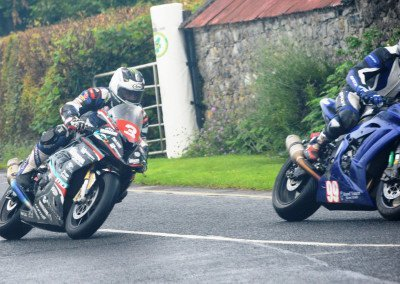 Negotiating his way through traffic, Michael Dunlop held steady pace in early stages of the 7-lap Race 1 then quickened.