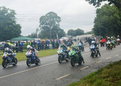 Wm. Dunlop takes hole shot in the 7-lap Supersport 600cc event with winner Derek McGee (#86) challenging.