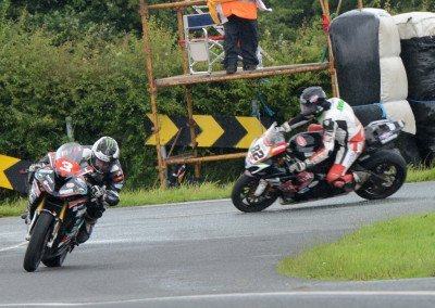 By half-way stage, Dunlop remains in front as Sheilds' runs a little wide at the Corr Cross apex