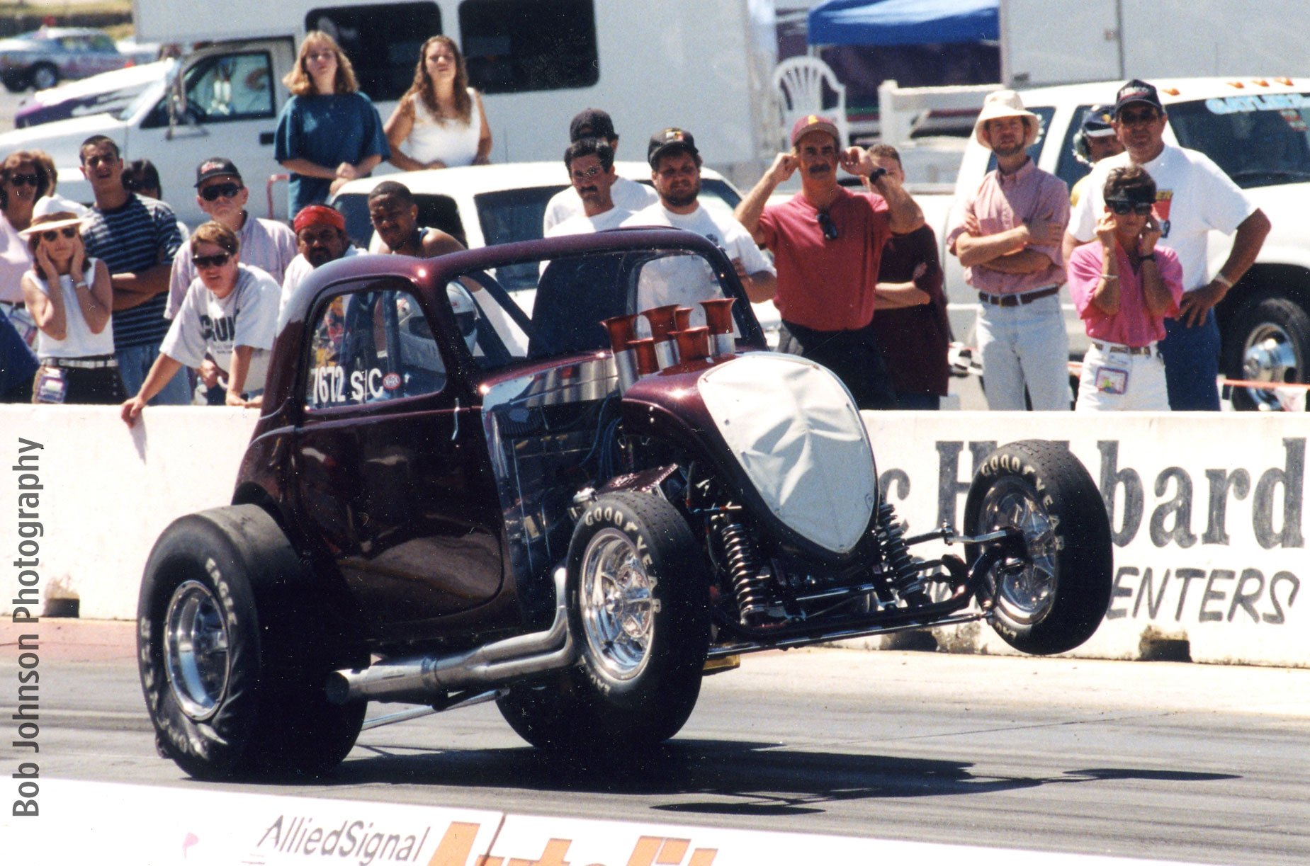 "Sears Point circa 1997-'98: The car following Roger Lamb's modifications. Its major specifications were as follows: 454 Crate LS-6 engine with stock crank, block, pistons and rods, minor head work, cam and injectors on alcohol. Two-speed Powerglide and Ford 9in. rear end.  Best time 8.52 at 153 mph. The car was raced for approximately 10 years both in competition and exhibition. Says Dave, ""It was retired to the NHRA Museum about 2004, which is where it remains. It was a fun ride!"""