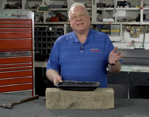 Two ball-peen hammers and one hard surface:  How to make oil pans, transmission and hydraulic pans leak proof
