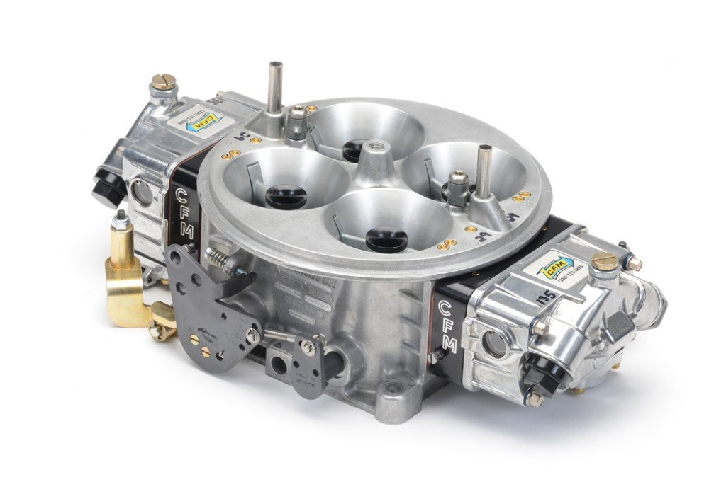 Dale Cubic's carburetor company, CFM, prepared this 4500-style 1250cfm unit. The brass air bleeds placed on each side of the vent tubes provide air flow adjustment for this three-circuit carburetor. The outer bleeds control the air feed to the idle circuits and the inner bleeds (next to the vent tubes) control the high-speed circuits. Those positioned between them control the intermediate circuits